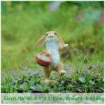 """<span class=""""title"""">ウサギ置物、ウサギ人形、子供うさぎを籐のカゴに入れて歩いているうさぎ、兎のフィギア、ウサギオブジェecqdrabbit023</span>"""