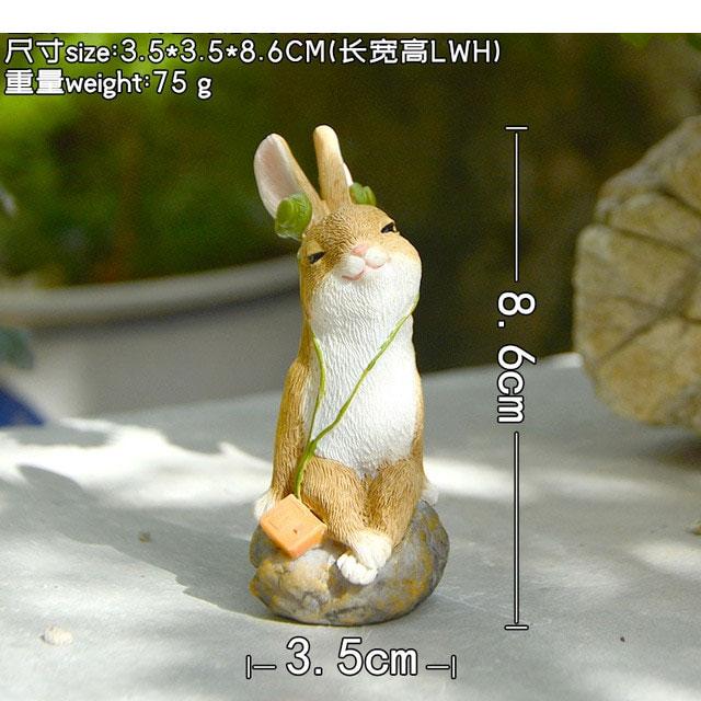 ウサギ置物、ウサギ人形、石の上にちょこんと座ってヘッドフォンで音楽を聴いているうさぎ、兎のフィギア、ウサギオブジェecqdrabbit028